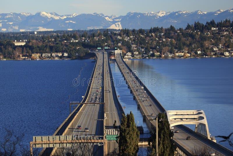 I-90 Bridge Bellevue Cascade Mountains. I-90 Bridge Seattle Mercer Island Highway Cars Snowy Cascade Mountains Bellevue Washington State Pacific Northwest royalty free stock photography