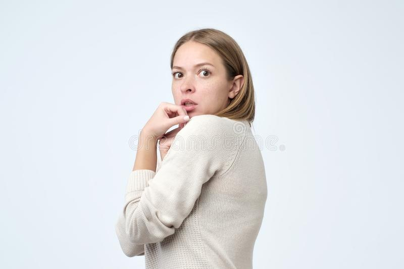 I am afraid to lose it. Portrait of the scared woman trying to hide something important from everybody. Human emotions, facial expression concept stock photography