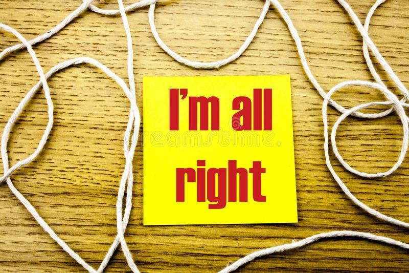 I am all right- word on yellow sticky note in wooden background. Bussines concept. stock photo