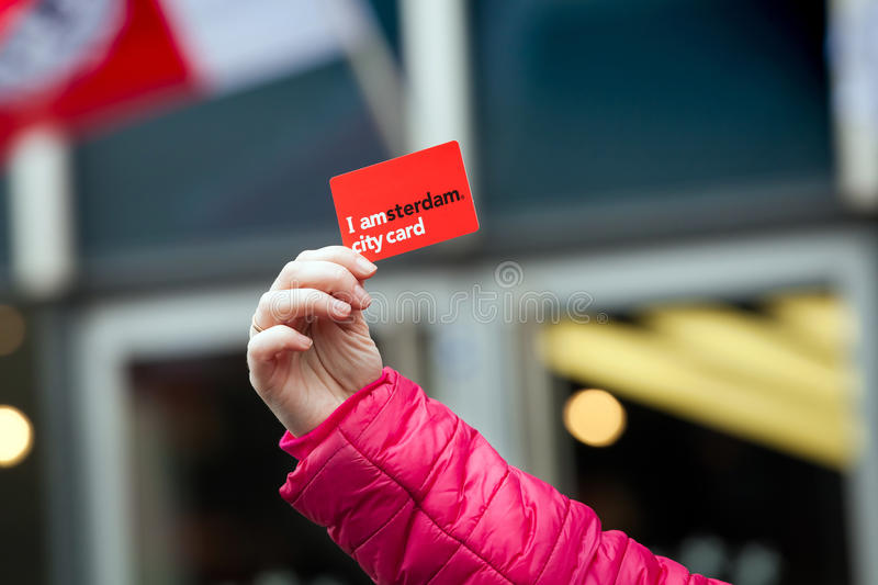 I am Amsterdam city discount card on woman hand in Amsterdam, Netherlands. Amsterdam, Netherlands - April, 2017: I am Amsterdam city discount card on woman hand royalty free stock image