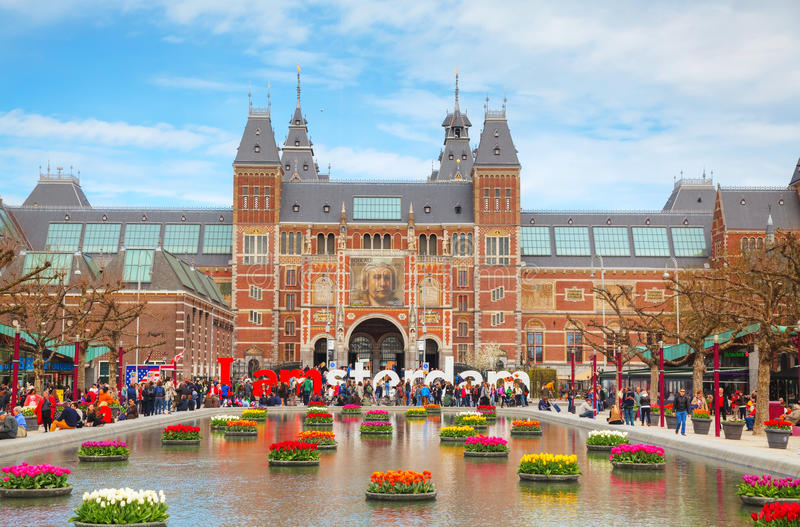I Amsterdam slogan with crowd of tourists stock image
