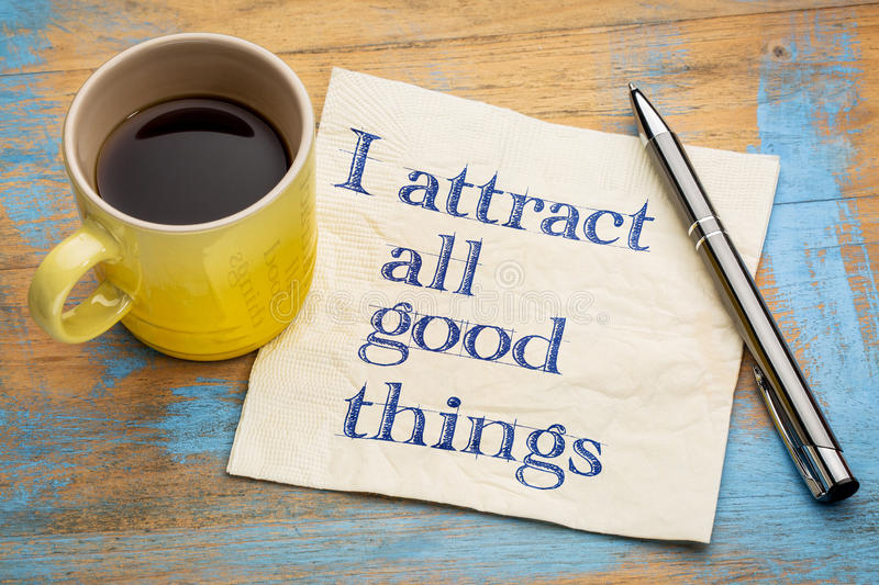 I attract all good things - affirmation. I attract all good things - positive affirmation words - handwriting on a napkin with a cup of coffee royalty free stock photos