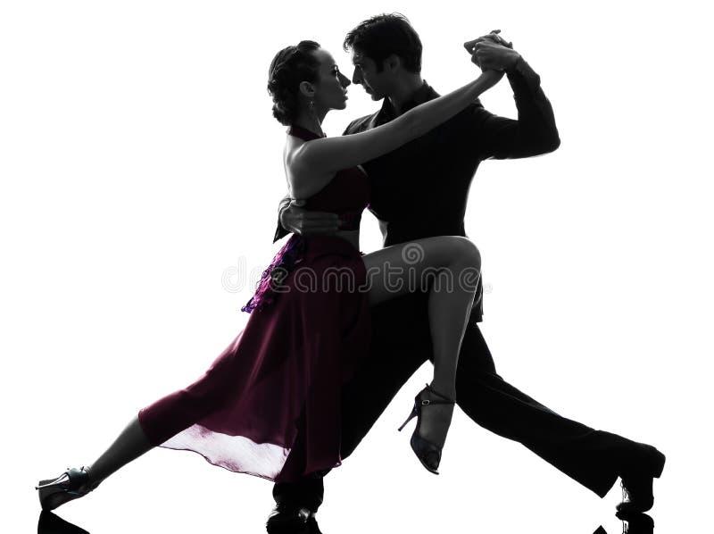 Ballerini della sala da ballo della donna dell'uomo delle coppie che tangoing siluetta immagine stock