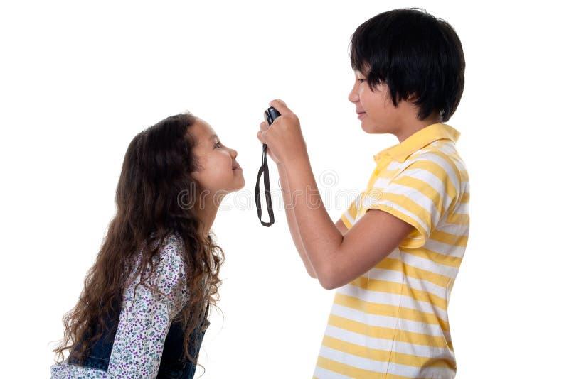 I bambini catturano le foto digitali immagini stock