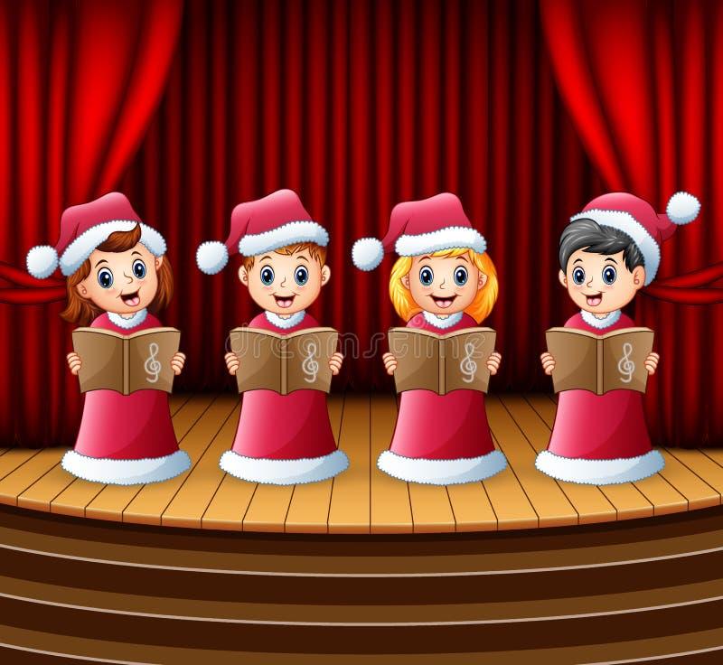 I bambini del fumetto in Santa rossa costume i canti natalizii di natale di canto sulla fase royalty illustrazione gratis