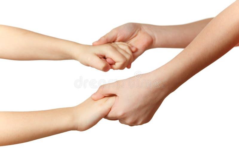 I bambini tengono le mani di ciascuno immagini stock