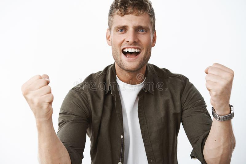 I believe in you. Portrait of supportive cheering handsome man with blue eyes and white broad smile trying encourage stock image