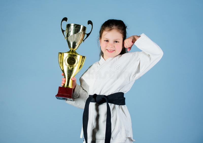 I am the best. knockout. energy and activity for kids. practicing Kung Fu. happy childhood. sport success in single. Combat. girl with champion cup. martial royalty free stock image