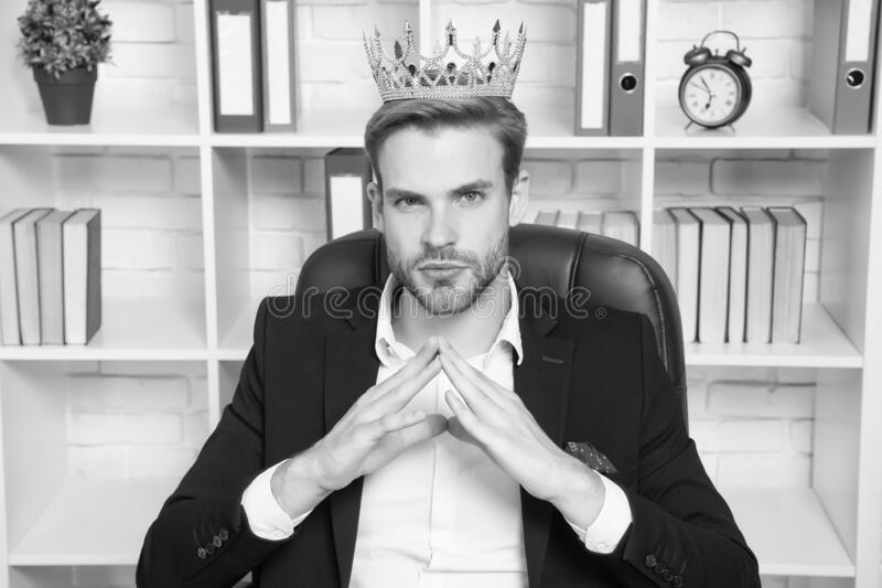 I am big boss here. Big boss in office. Big boss wear crown on head. Director or big boss. Confident businessman or ceo. Successful employer. Formal wear and stock photos