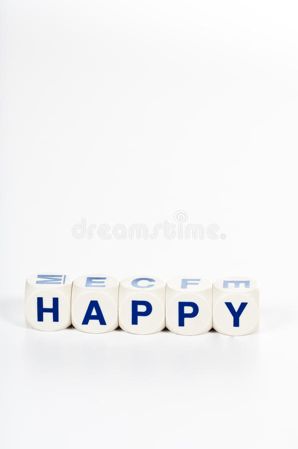 I blocchi ortografano la parola felice fotografia stock libera da diritti
