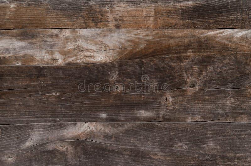 i bordi marroni di legno aderiscono strettamente l'un l'altro immagini stock