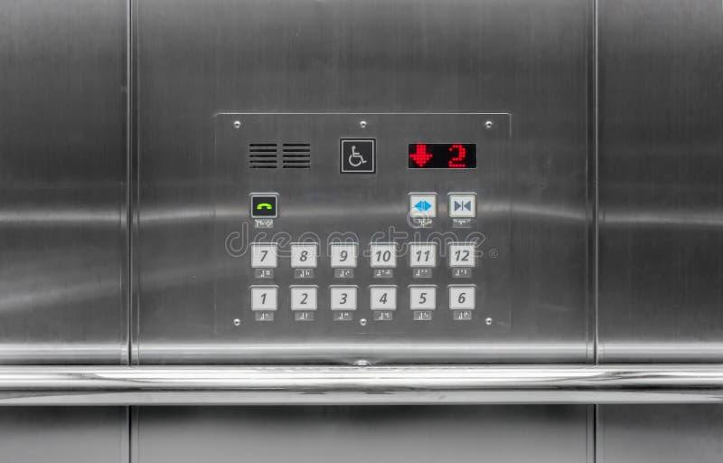 I bottoni dell'elevatore poliziotto di funzionamento del pannello dell'automobile o rivestono immagini stock libere da diritti
