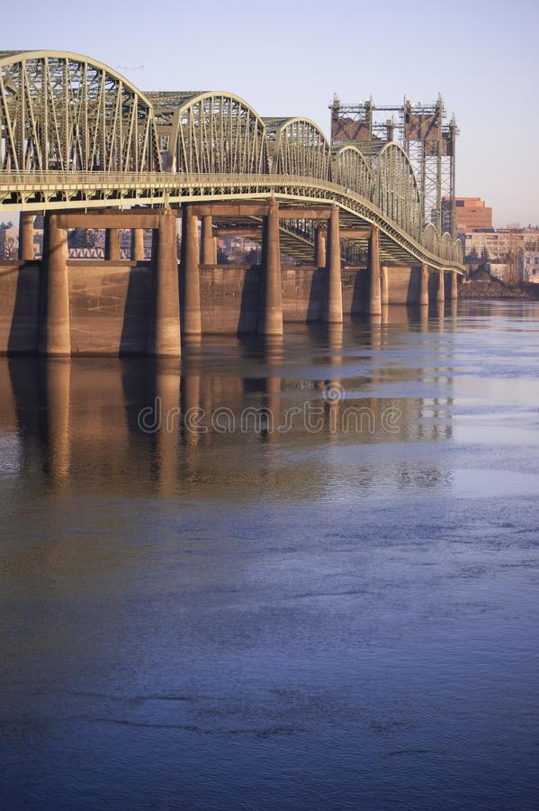 I5 Bridge relecting in the Columbia River. A golden hour image of the I5 bridge reflecting in the water while arching over the Columbia River from Portland royalty free stock photo