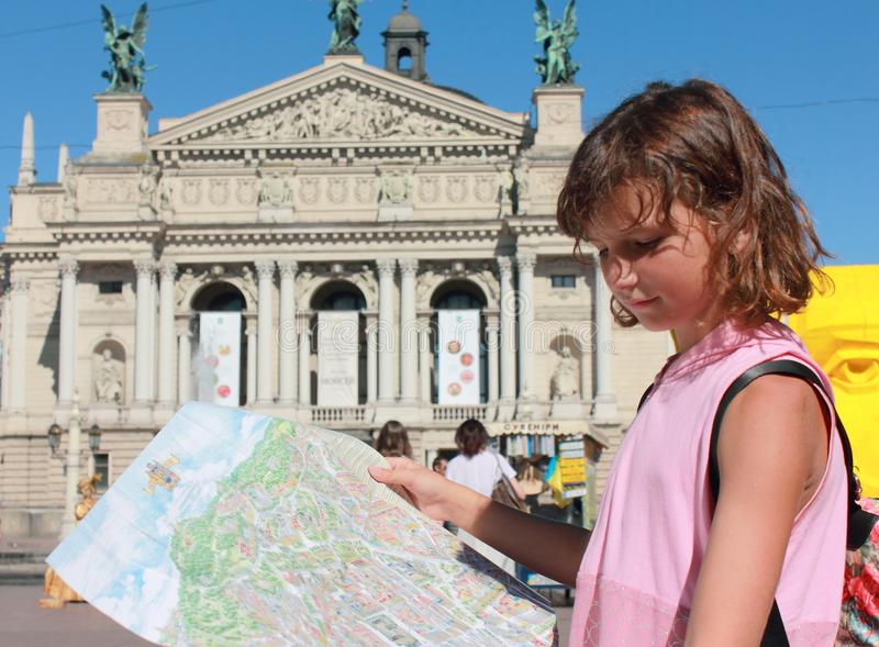 I can carry you a tour of our city. The child knows his favorite city, all his sights and familiar streets. This child lives in the city of Lviv and loves his royalty free stock photo