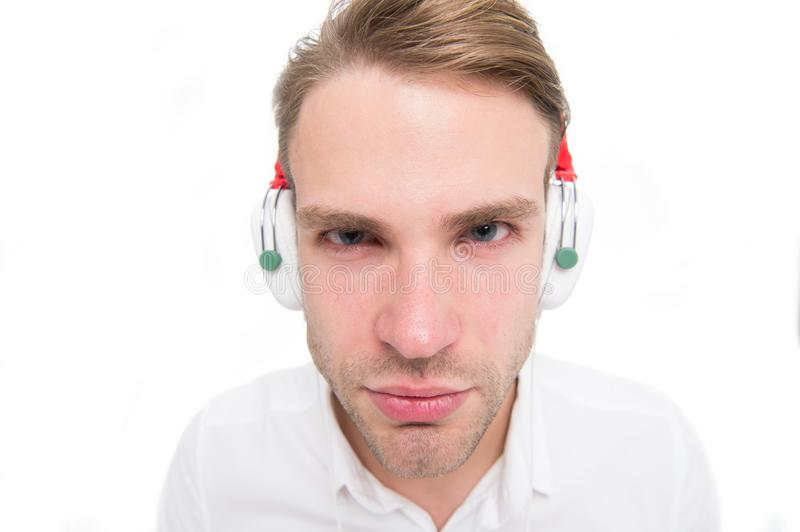 I can not hear you. Guy with earphones listens music. Man concentrated face listening favourite song in headphones. Man royalty free stock photo