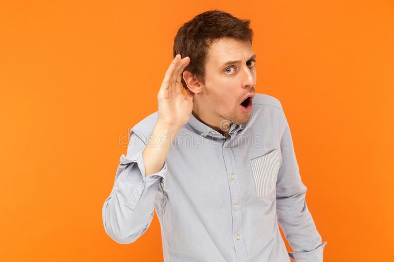 I can not hear you. Man have a funny look . royalty free stock image