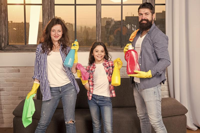 I can totally make that. Just Like Home. Professional Service. Family clean house. Happy family hold cleaning products stock photography