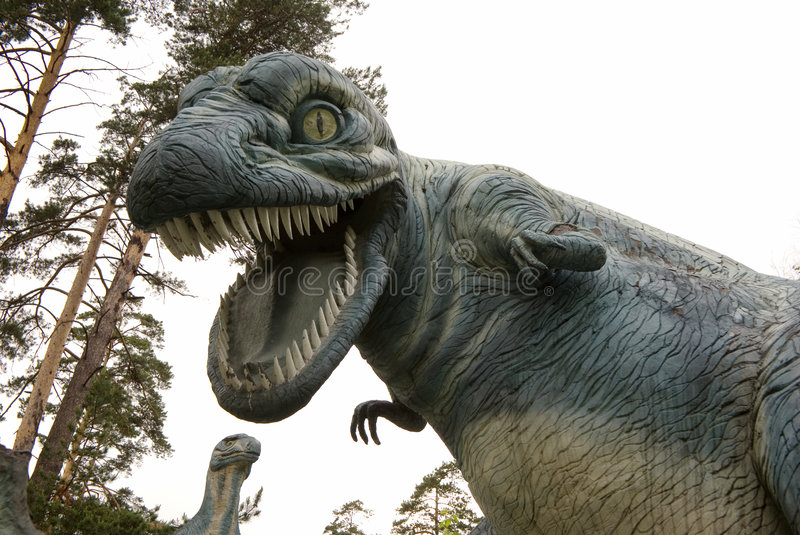I caught you!. A huge dino attacking you royalty free stock images