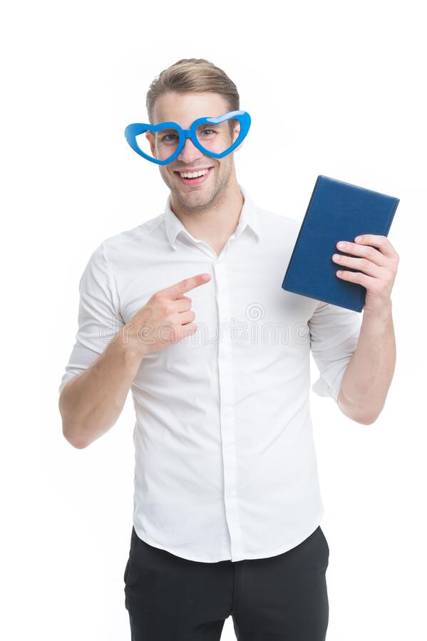I choose book. Happy man point finger at book. Funny guy read book in fancy glasses. Nerd and bibliophile. Geek and. Bookworm. Home library. Book shop. Reading stock photography