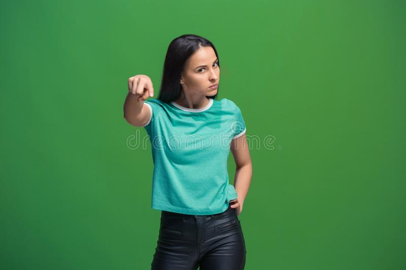 The overbearing business woman point you and want you, half length closeup portrait on green background. royalty free stock photo