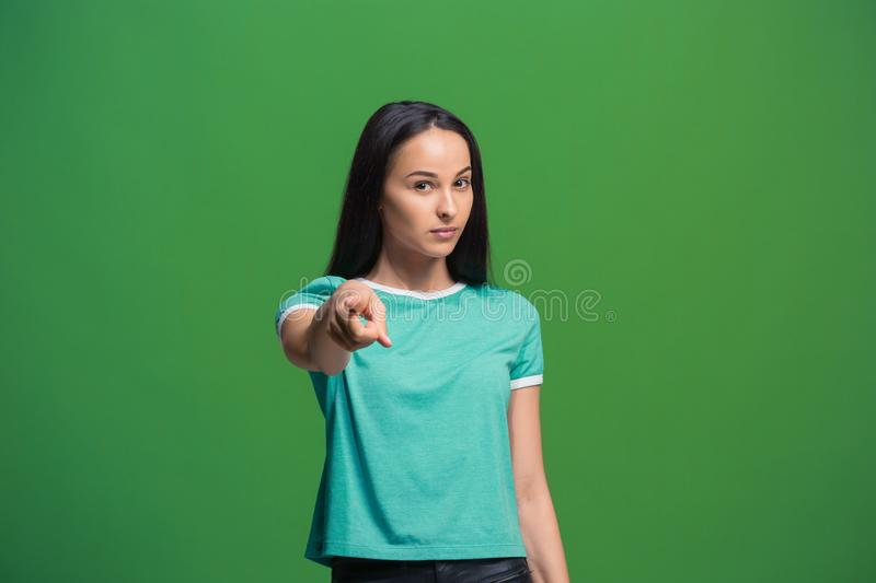 The overbearing business woman point you and want you, half length closeup portrait on green background. stock photos
