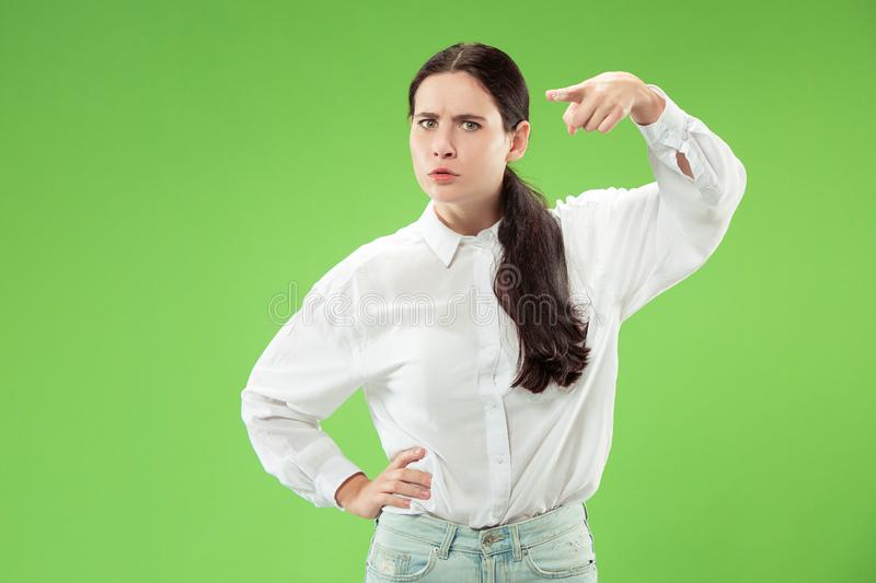 The overbearing business woman point you and want you, half length closeup portrait on green background. stock image
