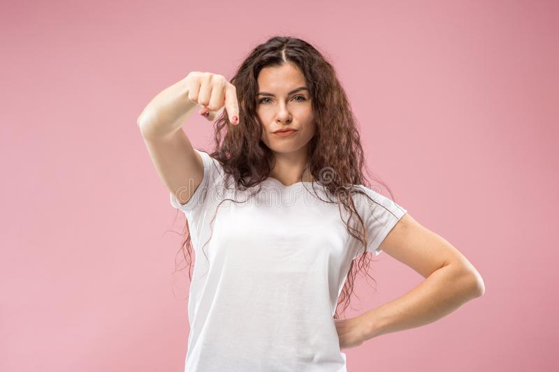 The overbearing business woman point you and want you, half length closeup portrait on pink background. stock photography