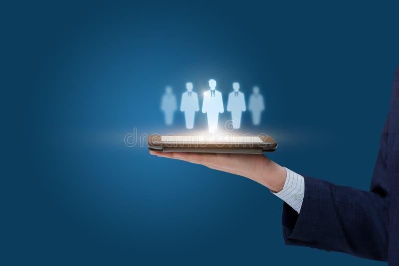 I clienti mirano a sulla compressa mobile immagine stock