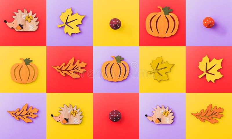 I controllori multicolori delle figure di legno elementi di autunno gradiscono le foglie, le zucche, i funghi, istrici Fondo di c fotografie stock