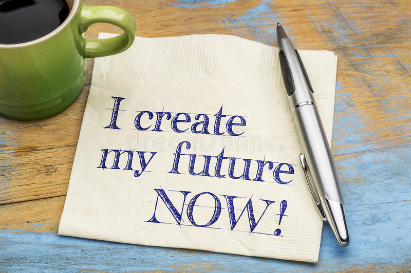 I create my future now - napkin. I create my future now - positive affirmation - handwriting on a napkin with a cup of coffee stock photography