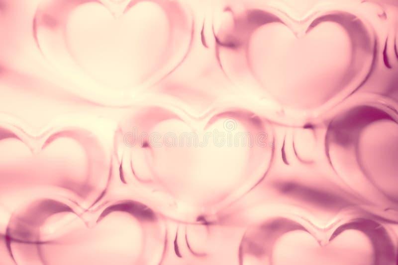 I cuori astratti modellano il fondo nel rosa - pastello ed annata royalty illustrazione gratis