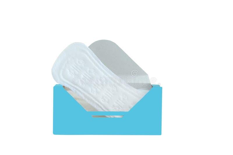 I cuscinetti sanitari quotidiani delle donne in scatola isolato bianco immagini stock libere da diritti