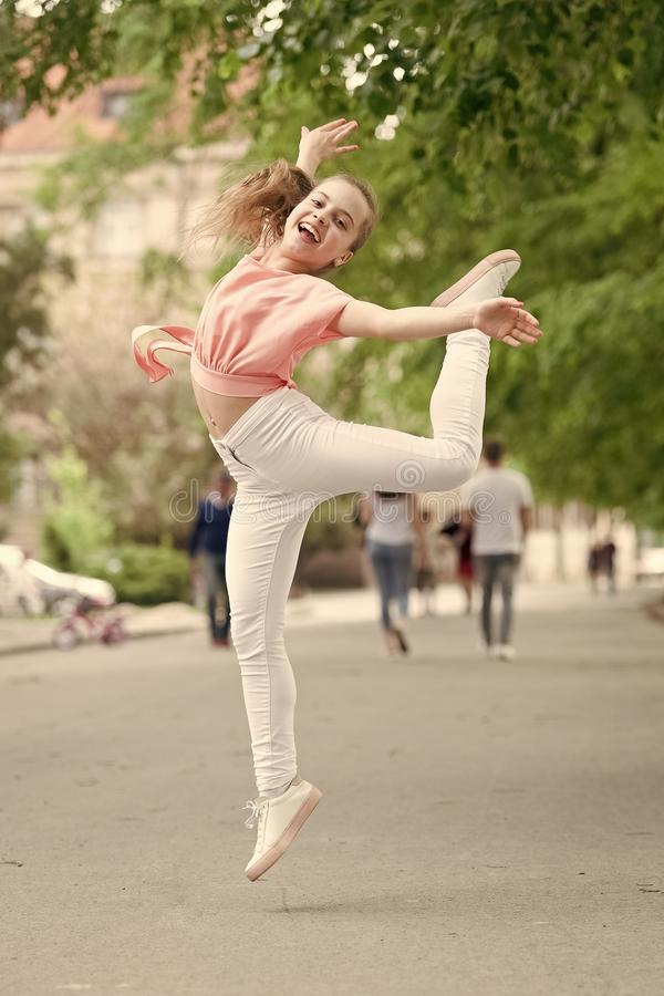 I am dancing roll up the floor. Dancing girl. Adorable dancer feeling free on city street. Small child enjoy dancing to stock photos