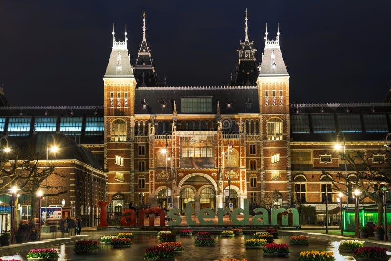 I de slogan van Amsterdam vroeg in de avond stock fotografie