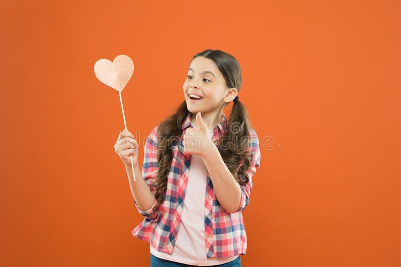 I definitely like this. Vote for love. Girl little child hold heart symbol on stick. Like and support. Valentines day. Fall in love. Love will save the world stock images