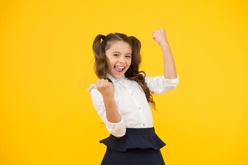 I did it. Happy schoolchild celebrating passing examination. Small child with winner gesture taking examination without. Attending classes. Satisfied with royalty free stock photography