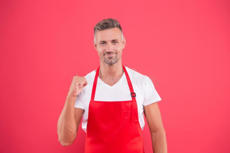 I do love cooking. Skilled and confident. Cook wearing bib apron. Bearded mature man in red apron. Mature guy in cooking royalty free stock images