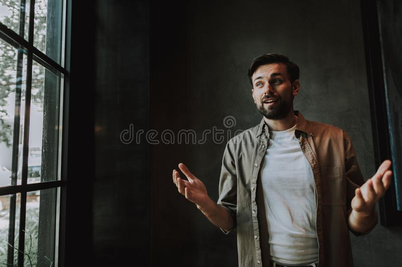 Happy unshaven male watching at the street stock image