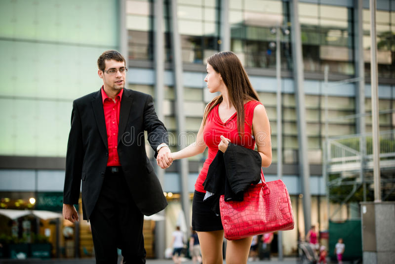 I do not want to go there. Hurry - young business women draging her boyfriend on street royalty free stock images