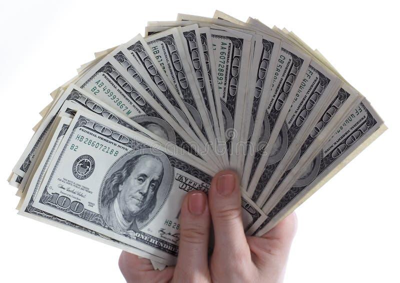 I dollari sono in mani. immagini stock