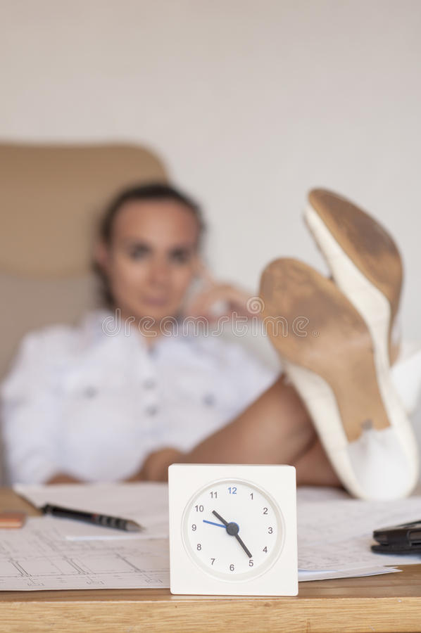 I don't work any more. Woman refusing to work late hours stock photos