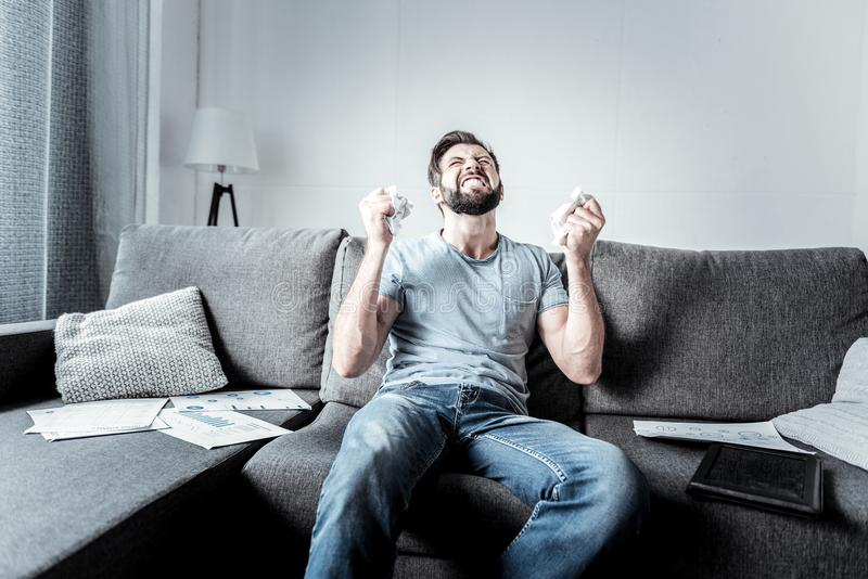Cheerless stressed out man having nervous breakdown stock photography