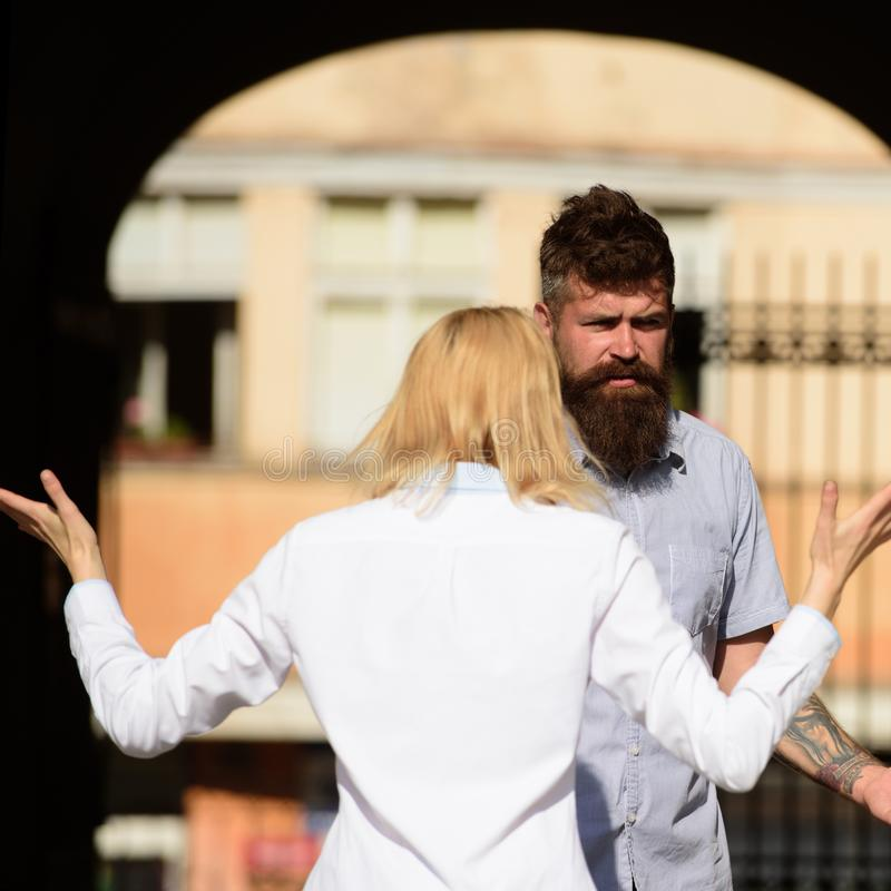 I dont understand you. Woman shouting and gesturing at bearded man. Couple in love quarreling on street. Conflict royalty free stock photos