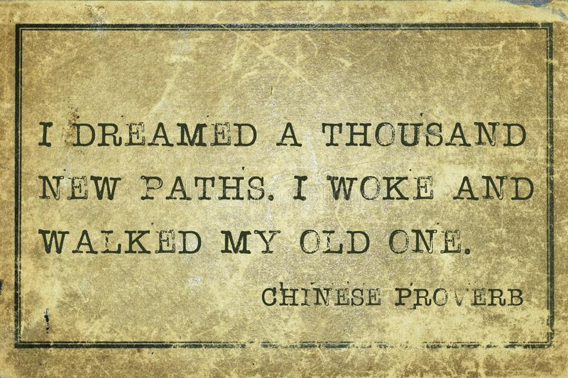 Own path CP. I dreamed a thousand new paths - ancient Chinese proverb printed on grunge vintage cardboard stock illustration