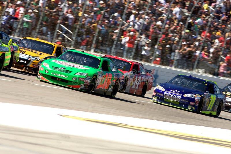 I driver di NASCAR al Texas vanno in automobile la gara motociclistica su pista immagini stock libere da diritti
