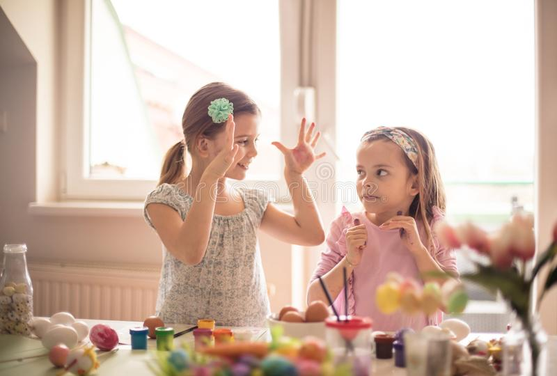 I ended my Easter decorating. Little girls coloring Easter egg royalty free stock images