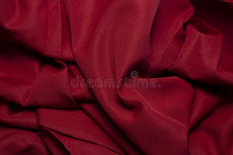 I felt scarlet 2. Aerial view of red fabric, with texture and wrinkles, chilliness, with soft sensation, background, texture and raw material royalty free stock photo
