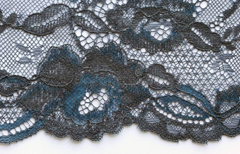 I fiori blu e neri merlettano il colpo materiale di macro di struttura fotografia stock libera da diritti