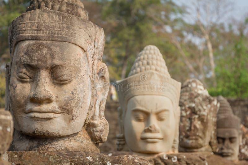 I fronti al tempio di Bayon, Siem Riep, Cambogia Fronte fotografie stock