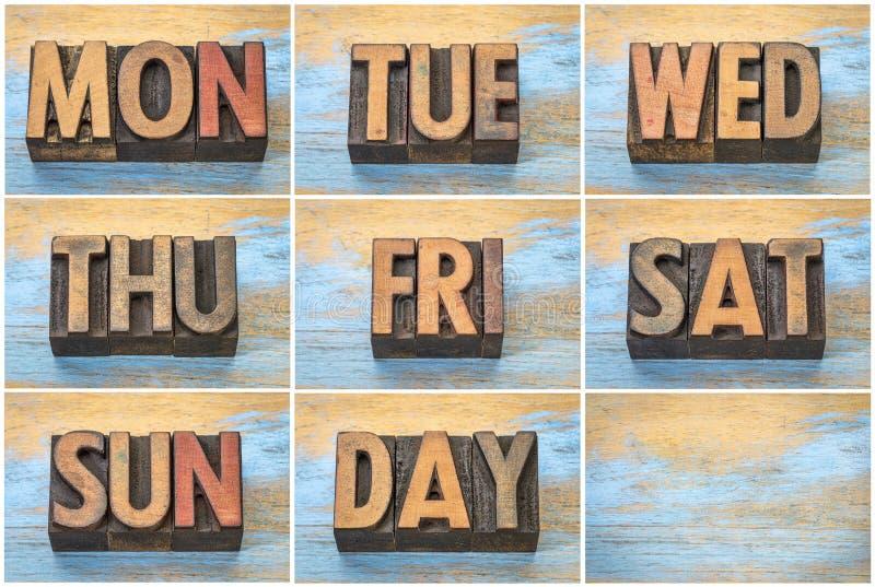I giorni della settimana in legno d'annata dello scritto tipografico scrivono fotografia stock